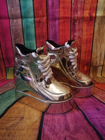 gold wedge platform trainers